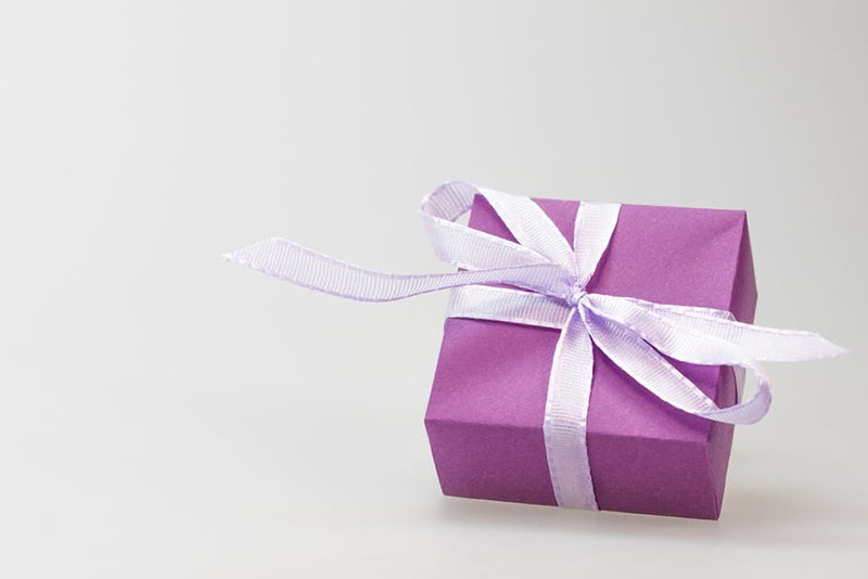A gift wrapped in purple